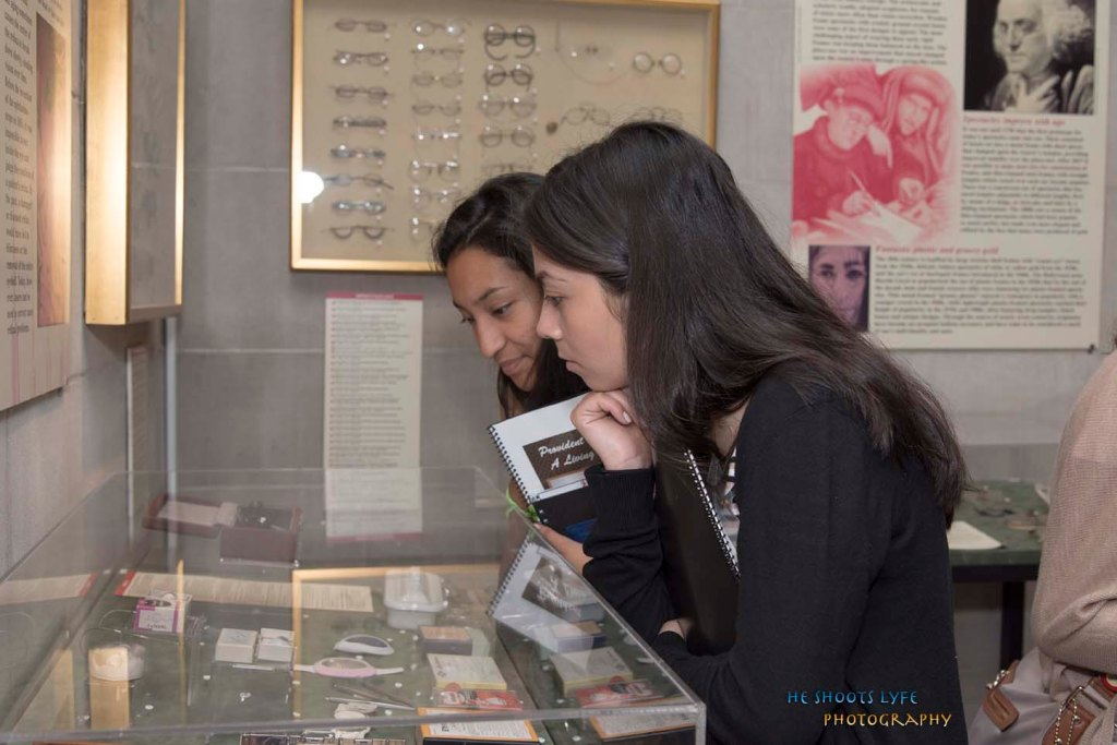 students looking at a display case in the ophthalmology exhibit