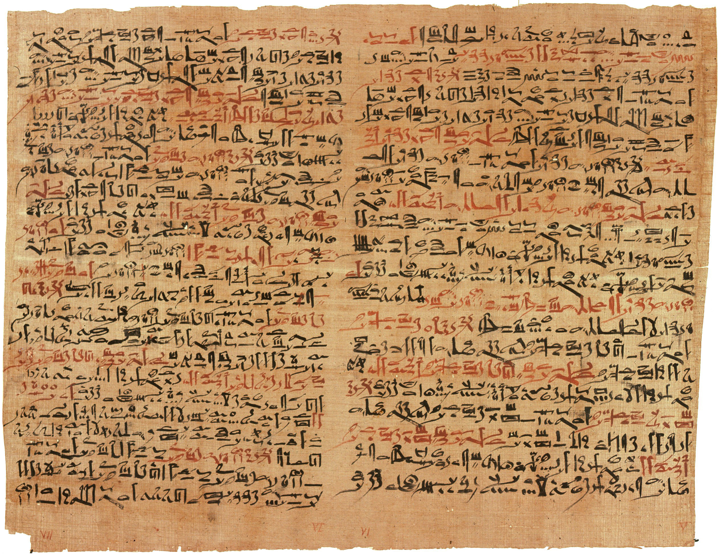 Image of papyrus paper that is old, brown, and worn. The text is written in two columns in black and red ink.