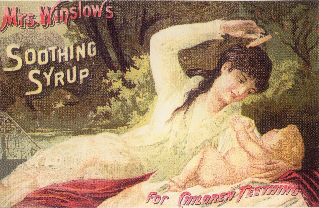 "Advertisement for ""Mrs. Winslow's Soothing Syrup"", from 1887. The syrup is advertised as a cure for teething and shows a mother administering the medicine to her infant in a peaceful outdoor setting."