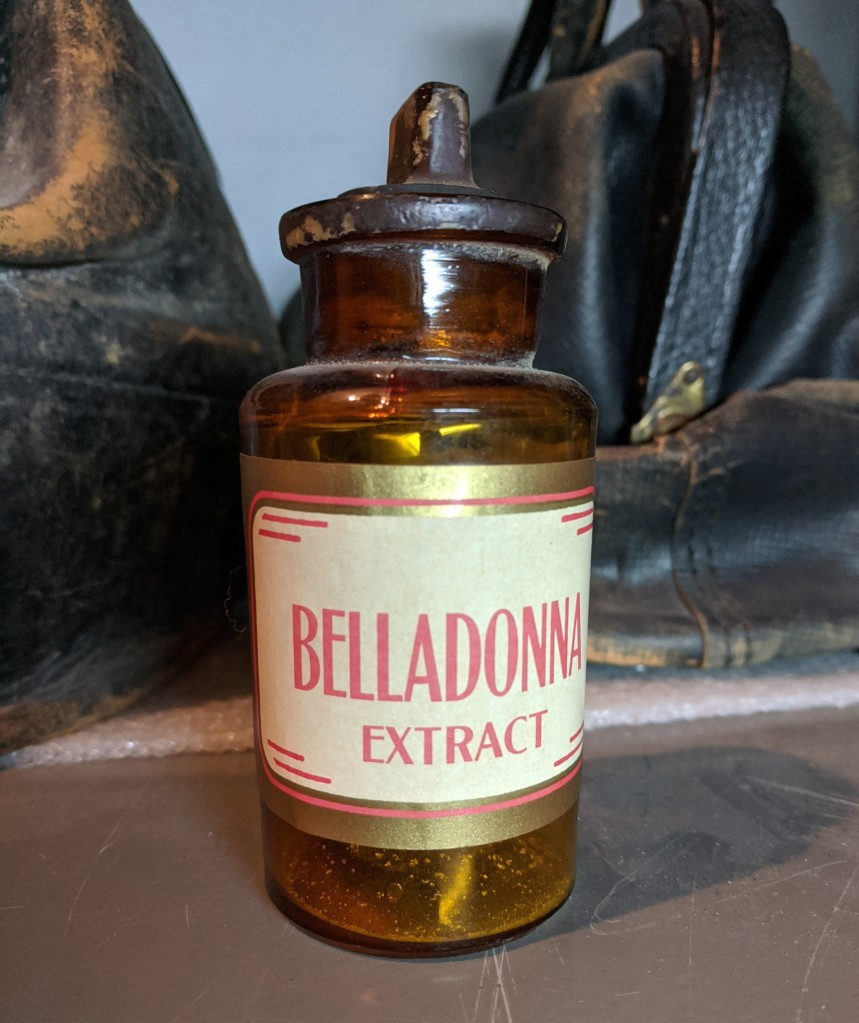 A bottle of Belladonna extract on a shelf.